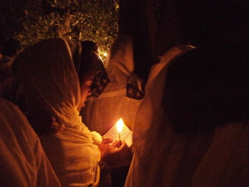 Prayer by candlelight - Timket, Gondar