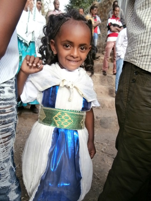 Girl with the largest forehead ever, wearing the cutest habesha libs