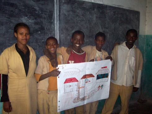 These kids were gobez! The pond in the bottom has the life cycle of the mosquito while the one house without the net has a sick person, the house with the bed net is cool, and they drew the health center!