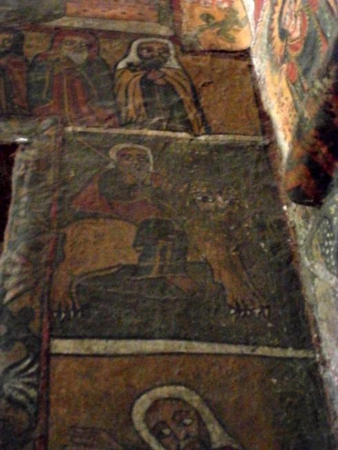Daniel on a lion, I assume after the lion's den