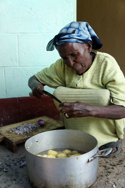 one of the house mothers making lunch