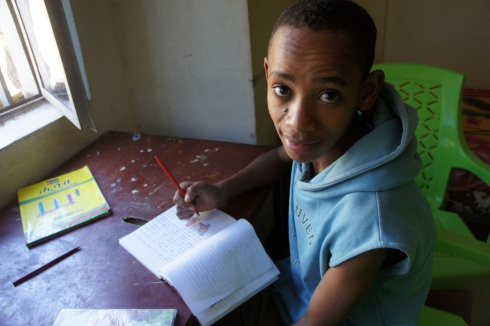 Doing homework at Fasil Shelter