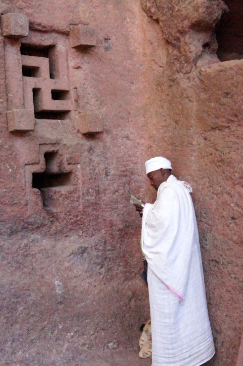praying on the wall, including an ancient swastica style cross