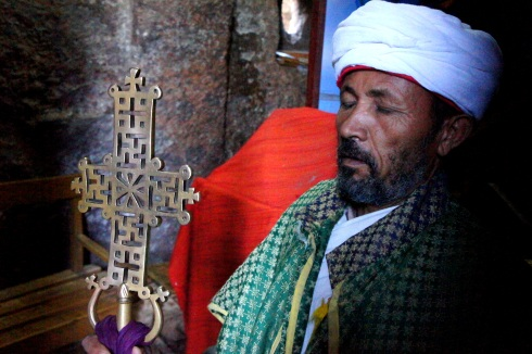 A priest with his cross
