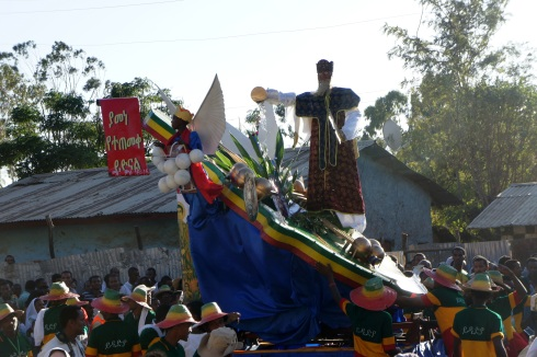 A priest pouring holy water float