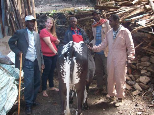 this was the cow that was slaughtered for the feast. Clearly, she had to take a photo with it.