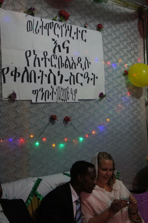 It basically says Congratulation Robel and Morgan on your engagement with the date of the Ethiopian calendar (Ginbot 10, 2006 aka May 18, 2014)