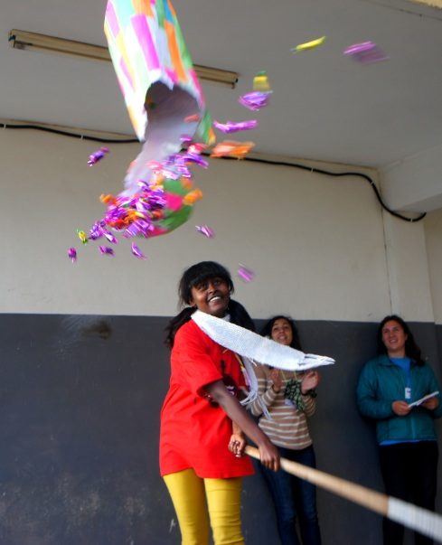 "breaking the pinata with her ""strong woman"" statement"