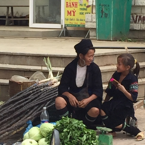 A Hmong woman with her daughter at the local Sapa market.