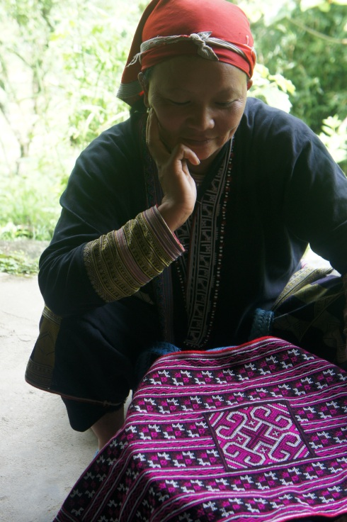 A Red Dzao woman from Ta Phin village and her homemade embroidery.